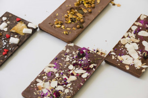 chocolate-bars-with-different-toppings-white-background+